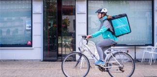 Repartidor de Deliveroo en bici